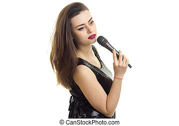 young lady in black dress with microphone