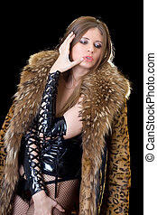 Young lady in latex suit and a fur coat