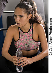 Young Lady in Sportswear Holding Bottle of Water