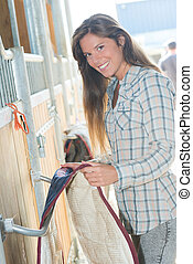 Young lady in stables