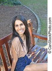 Young lady on park bench