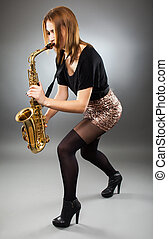 Young lady playing the saxophone