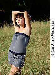young lady posing in a meadow