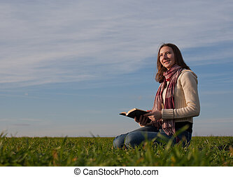 Young lady reading a book