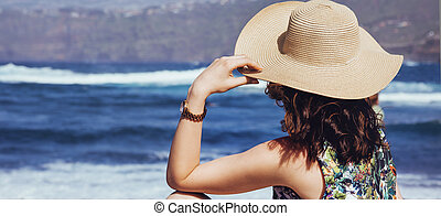 Young lady resting on the beach
