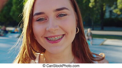 Young Lady Smiling Outdoors. Emotion - A young pretty lady...