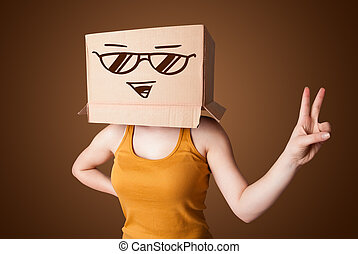 Young lady standing and gesturing with a cardboard box on...