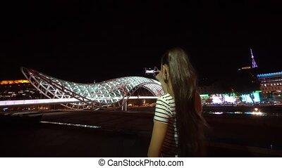 Young Lady Taking Photos of the Bridge of Peace. - Tbilisi,...