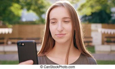 Young Lady Using a Phone in Town