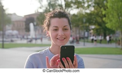 Young Lady Using Phone in Town