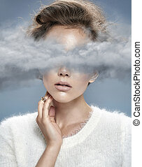 Young lady with head in the clouds