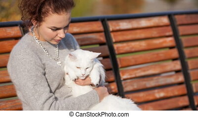 young lady with Maine Coon cat