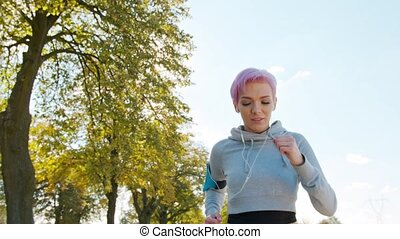 Young Lady with Pink Hair Jogging in the Suburbs. Glitch - A...