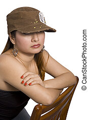 Young lady sitting on a chair and looking sad