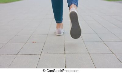 Young Lady's Feet Walking on the Cobblestone