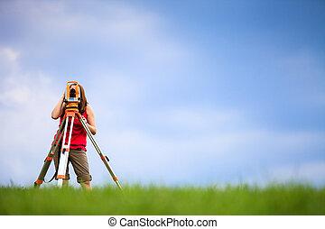 Young land surveyor at work