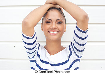 Young latin american woman smiling on white background