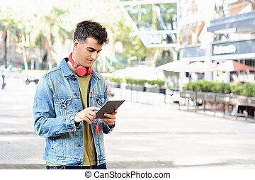 man using a tablet.