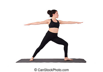 Young latin woman doing yoga pose.