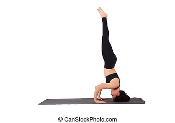 Young latin woman practicing yoga