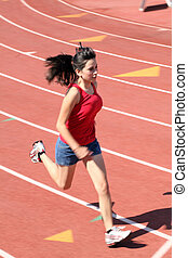 young latina girl running on track shorts red top