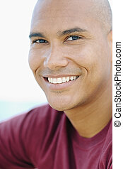 young latino man smiling at camera - portrait of young...