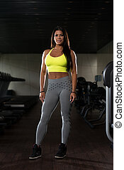 Young Latino Woman Posing In The Gym