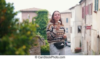 Young laughing woman eating ice cream. Then she goes into...