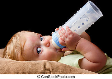 Young little baby drinking from his bottle