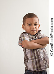 Young little boy in checkered shirt and jeans