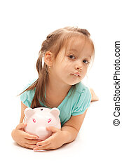 Young little girl holding a piggy bank