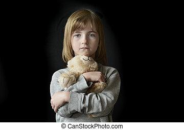 Young Little Girl Holding Teddy Bear