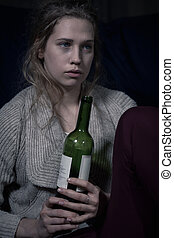 Young lonely woman with wine