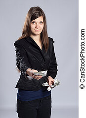 Young long-haired woman holding money