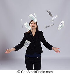 Young long-haired woman throw money