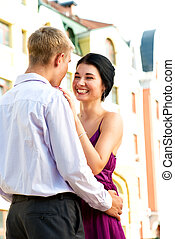 Young loughing couple on street - Young attractive couple ...