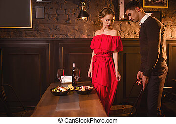 Young love couple in restaurant, romantic date
