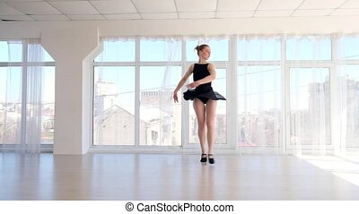 Young lovely ballerina practising ballet moves - Young...