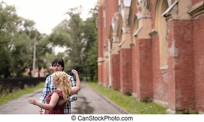 Young lovely couple dancing outdoors in summer. Romantic dating or lovestory