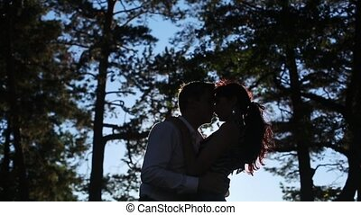 Young lovely couple kissing in a park