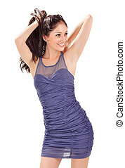 Young lovely lady in blue pleated sun-dress playing with hairs