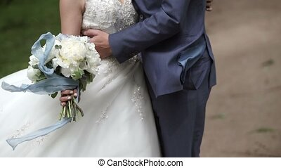 Young lovely wedding couple embracing