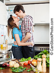 loving couple flirting  in domestic kitchen