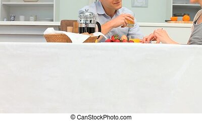 Young loving couple having a breakfast