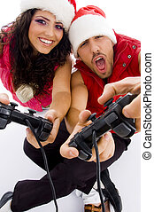 young loving couple on floor playing video game