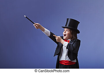 Young magician performing with a magic wand