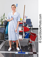Young Maid Cleaning The Floor - Young Happy Maid Cleaning ...