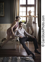 Young male and female models posing in a stylish interior