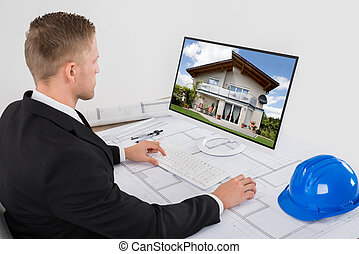 Architect Working On His Computer In Office