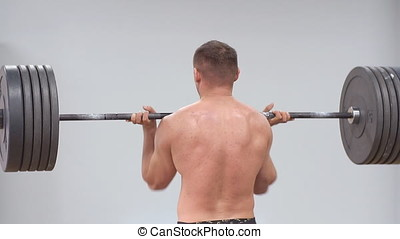 Young Male Athlete Trains With A Barbell In The Gym. Slow motion.